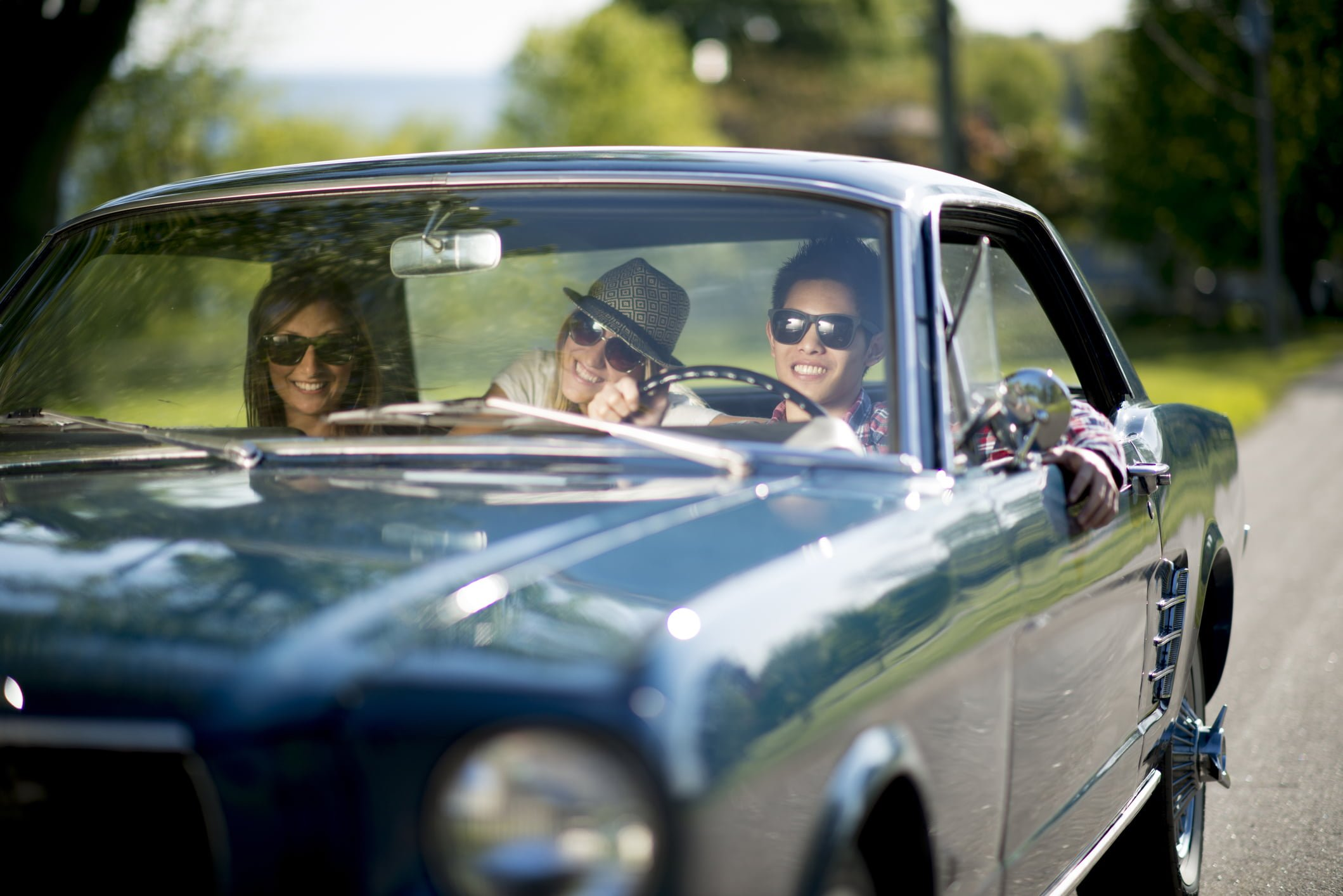 Group of friends driving a Classic Car