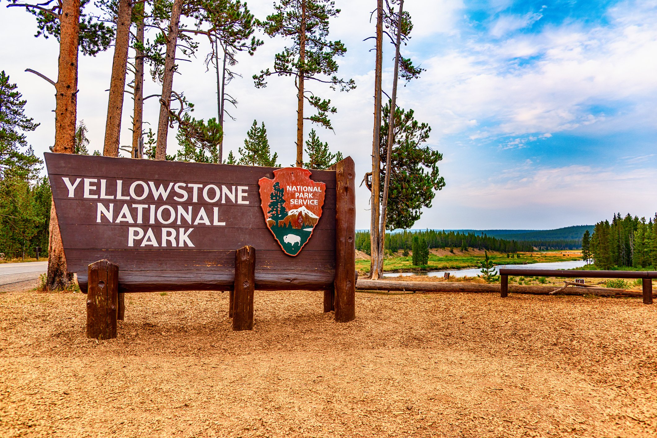 Yellowstone National Park, United States - August 16, 2018: The sign at the south entrance to Yellowstone National Park, America's first officially designated national park, located in Wyoming, USA.