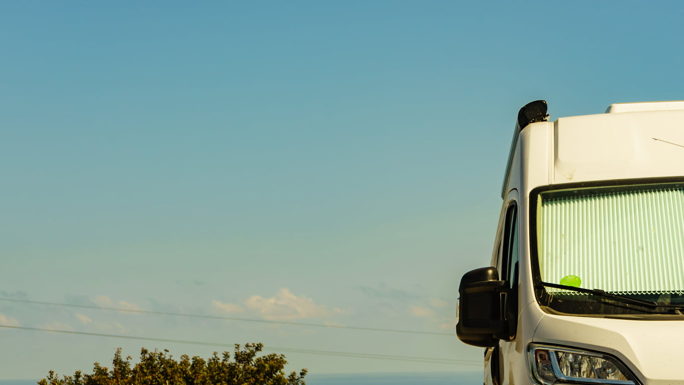 Camper car against sky, camping on nature