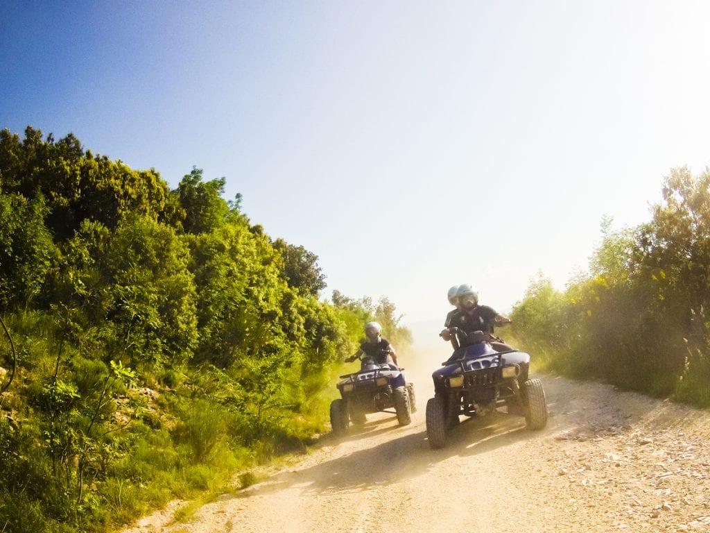 two guys on quad bikes in mountain trail