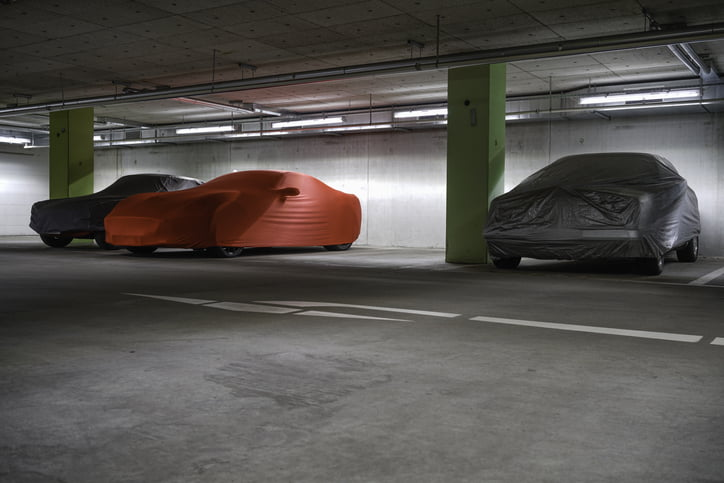 covered cars in underground car park