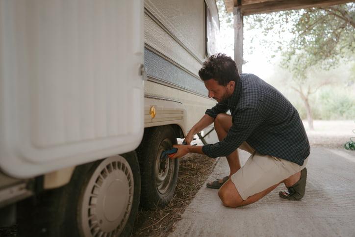 Man repairing RV tire